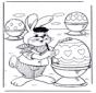 Пасхальный заяц красит яйца